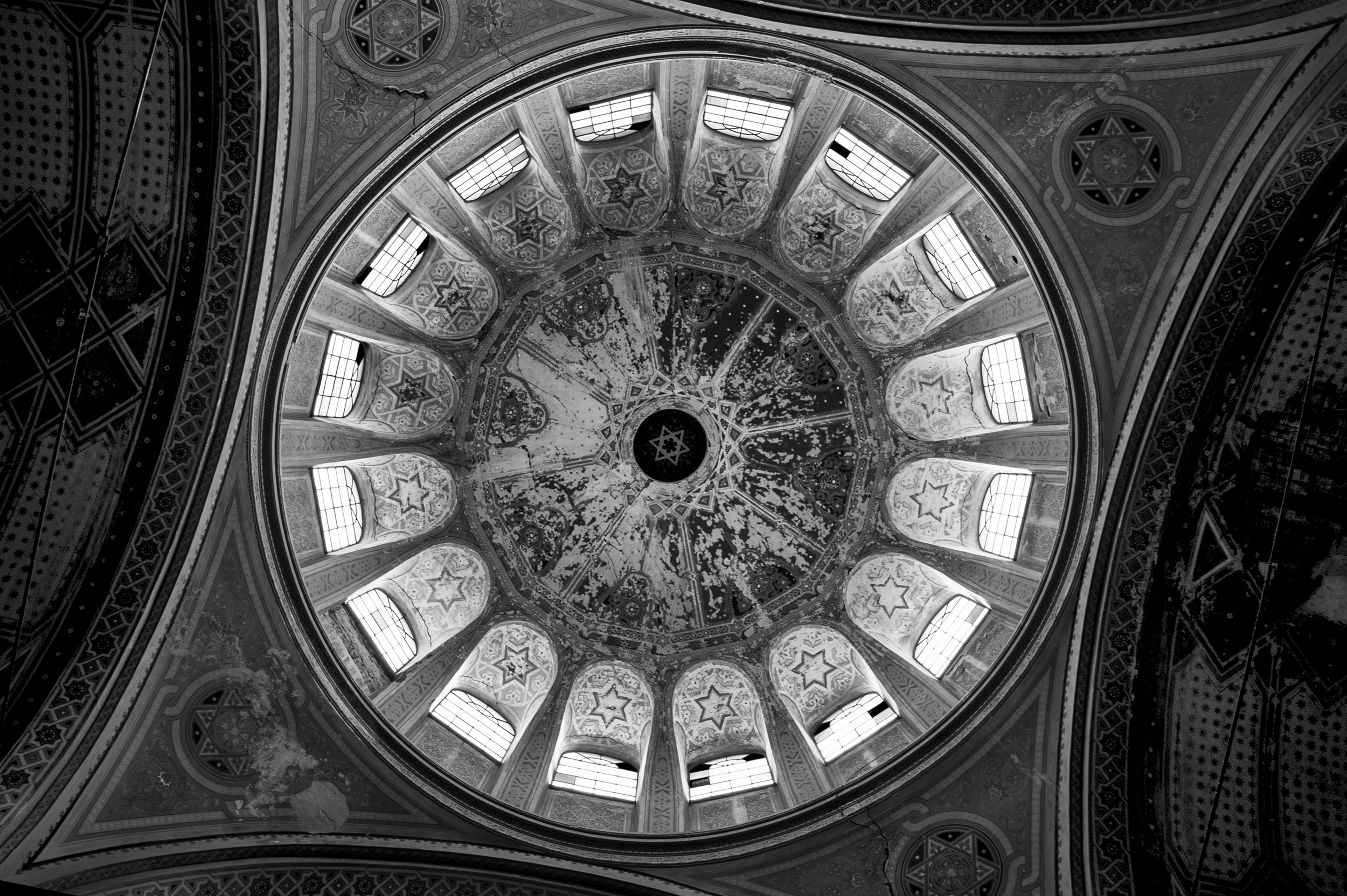 The crumbling dome of the Zion Neologic Synagogue towers above the sanctuary floor below on April 10, 2013. The thousand-seat Zion Neologic Synagogue was one of the largest in all of Europe before the Second World War, but sat empty for decades during communist rule in Romania.