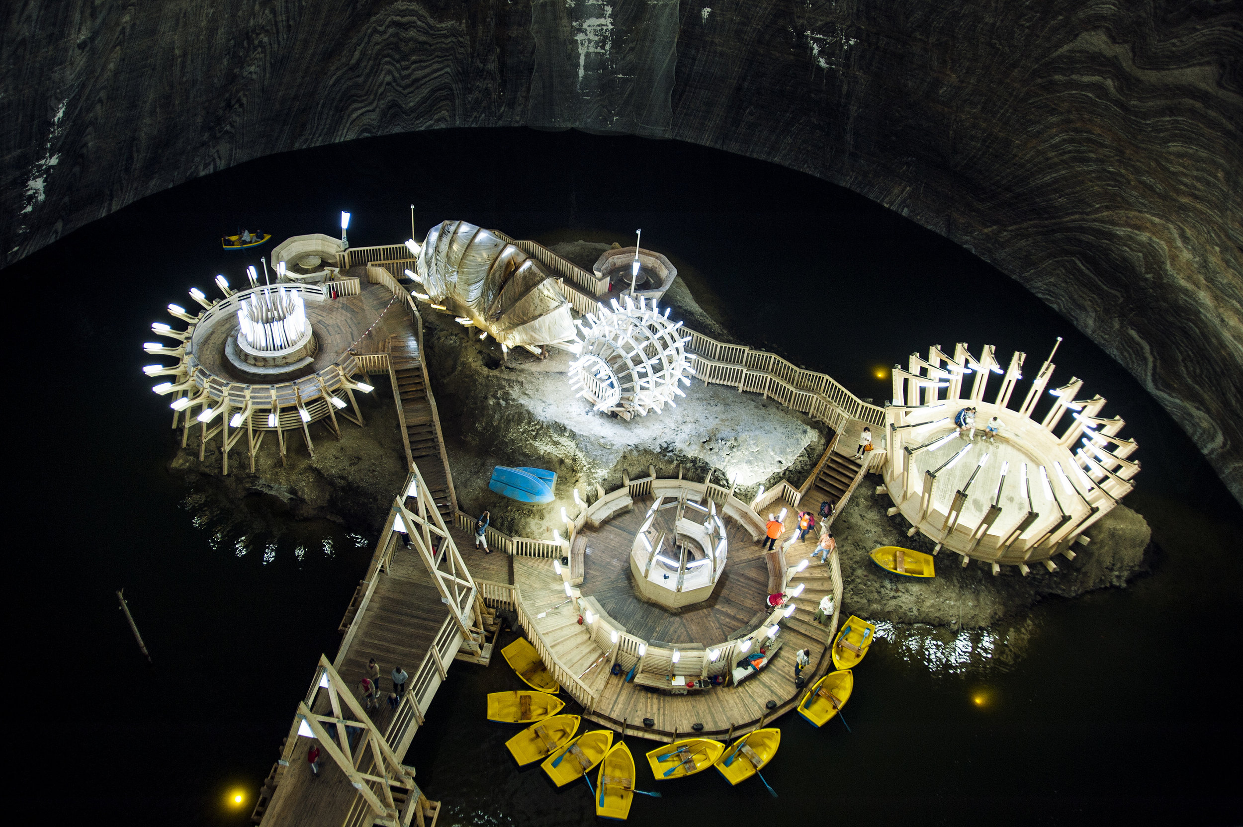 The Turda salt mines near central Romania are home to massive caverns once at the forefront of Romania's salt mining industry. Today, visitors can take a boat ride hundreds of meters below the surface or enjoy the magnificent cathedral-like structure.