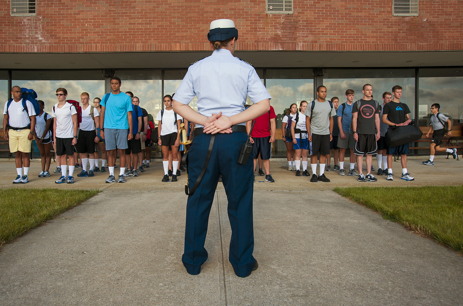 NEW LONDON- 06302014-- Officer Morin of Delta Company looks over new recruits, or Swabs, during R-Day of the United States Coast Guard Academy's Swab Summer in New London on Monday, June 30, 2014.(DANIEL OWEN | The Hartford Courant)
