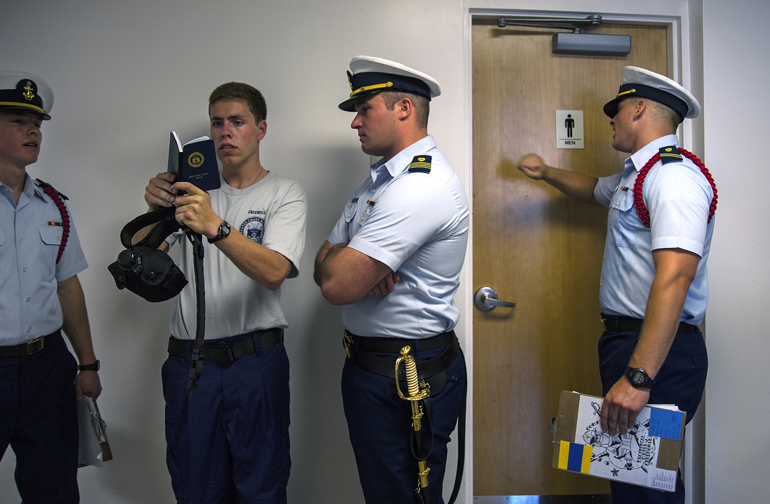 NEW LONDON- 06302014-- USCG Academy Cadres relentless push swabs to move at a quicker pace, never allowing them the chance to get comfortable in the Coast Guard's attempt at making the swabs work as a team and follow instructions during the USCG Academy's Swab Summer in New London, CT on June 30, 2014. (DANIEL OWEN | The Hartford Courant)
