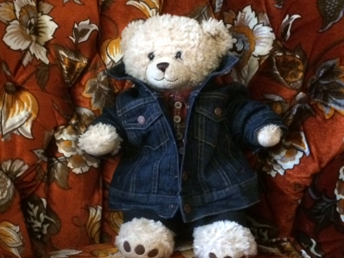 Here it is being modeled by Baby Dyke Bear.  Isn't that adorable?  Not to mention I have basically the exact same denim jacket in me size.  Baby and I can be matchy matchy.