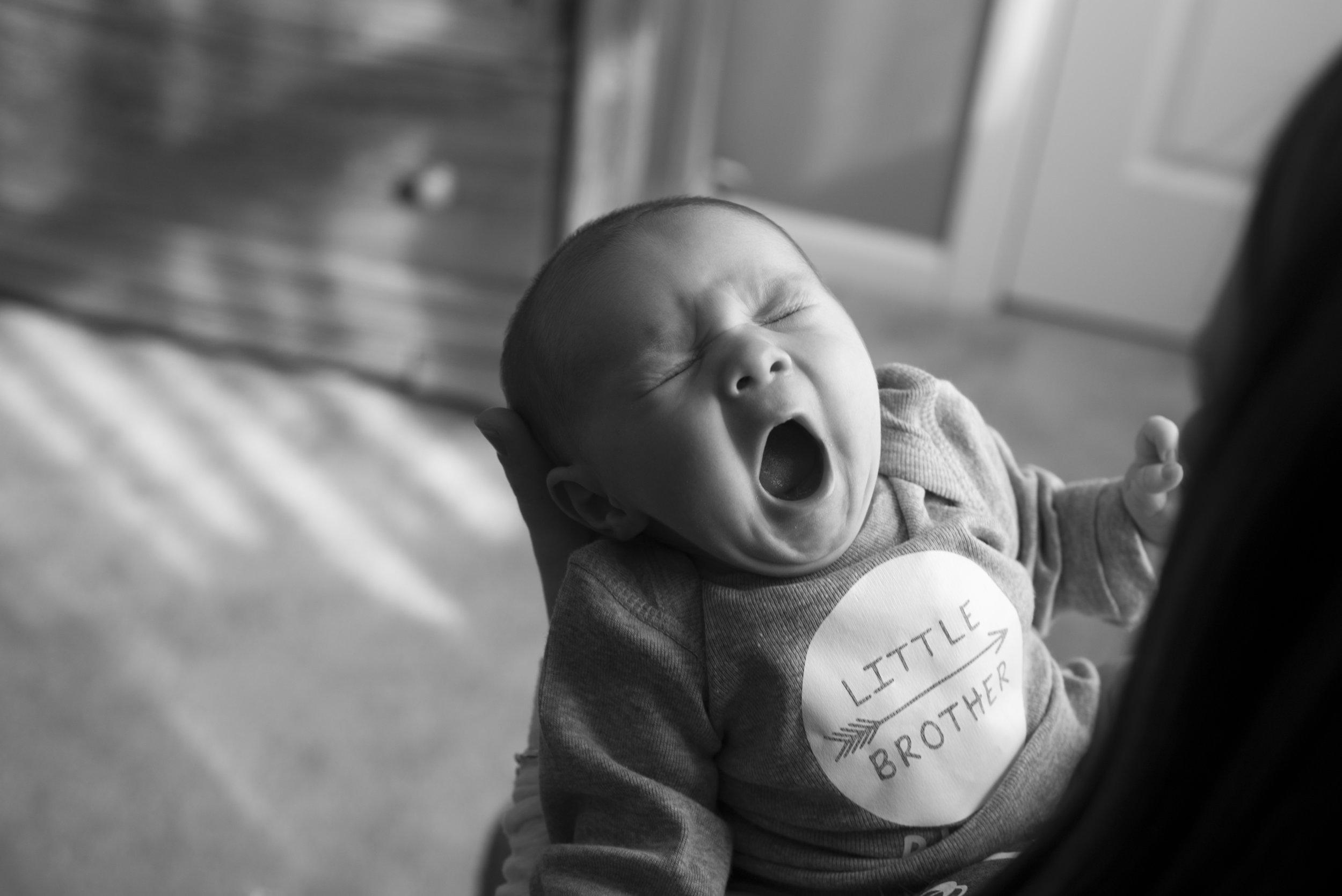 Pittsburgh Lifestyle Newborn Photography new baby yawns.jpg