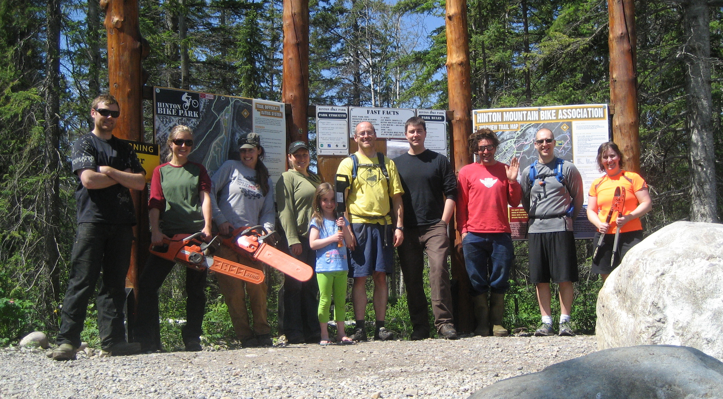 """Volunteers for the building of the advanced flow trail """"Stinger"""" in summer of 2013."""
