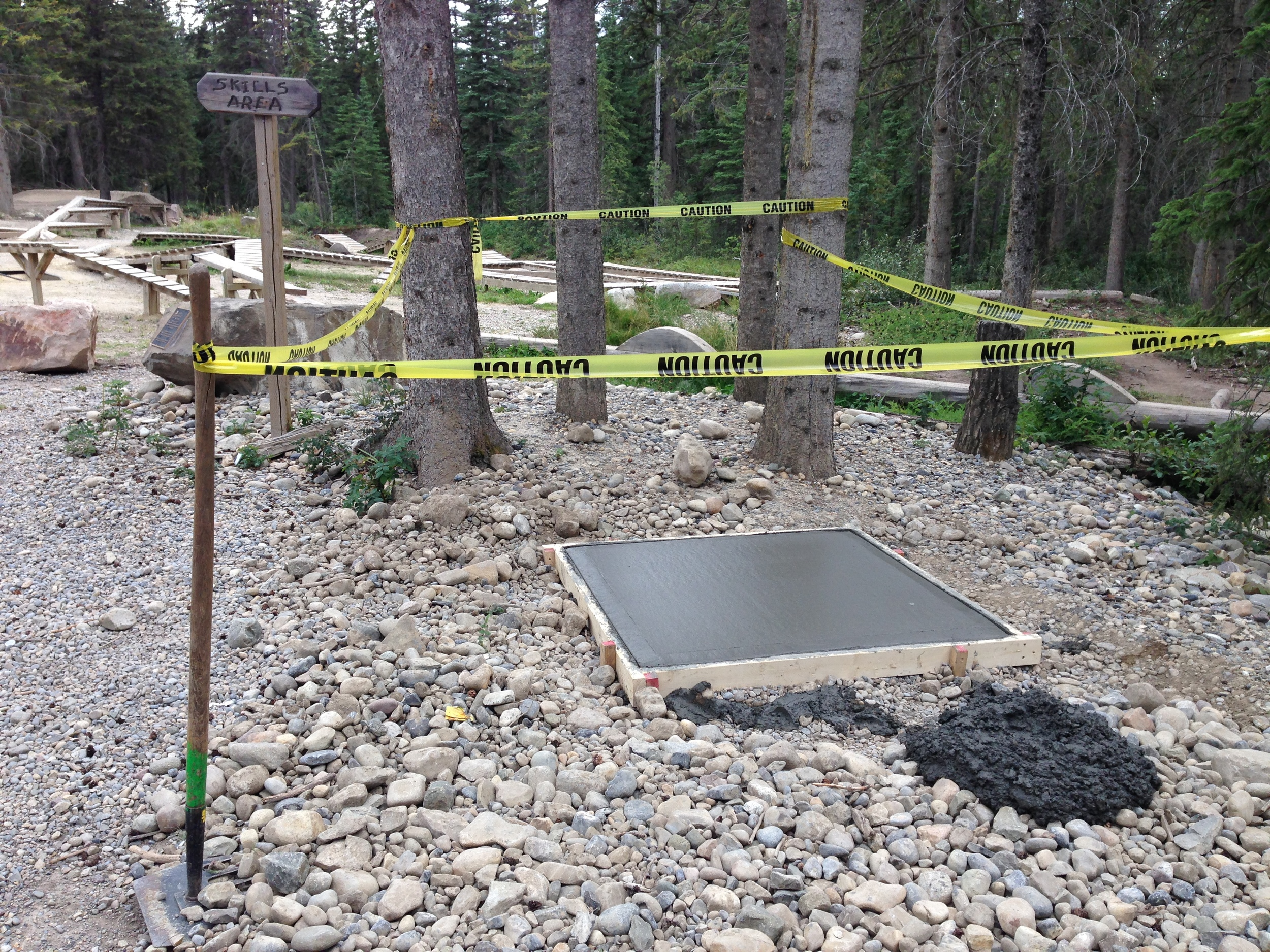 Cement was poured on Thursday for a small cement pad that will be home to a Fix-It station for the Hinton Bike Park.  Thanks to West Ridge Sand & Gravel for the donation of the cement!