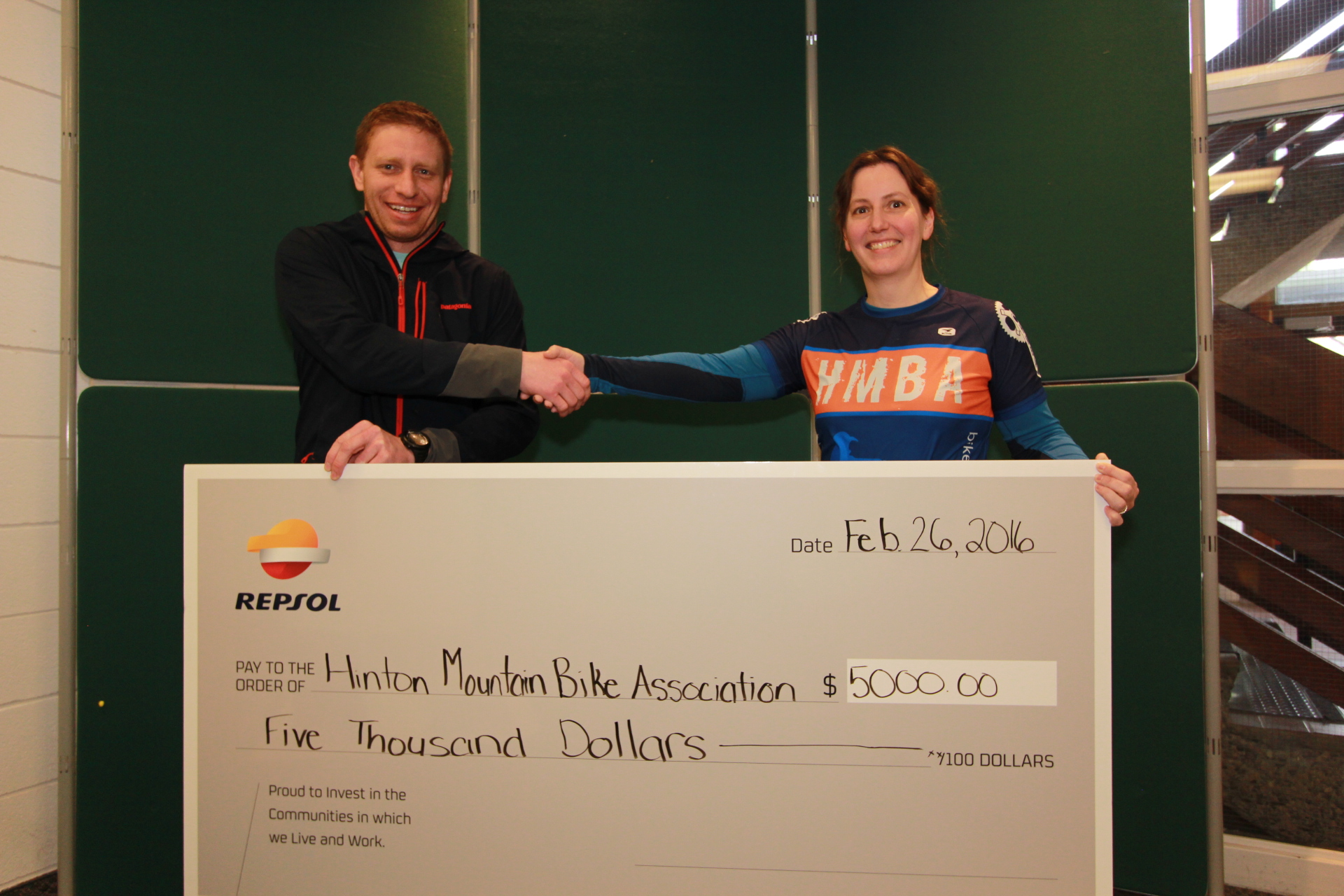 Julie Duval, HMBA VP, accepting the cheque from Jesse Kirillo of Repsol.