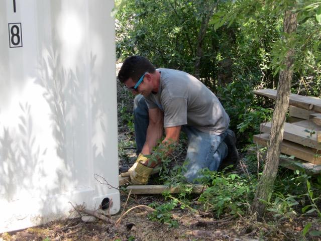 Tyson working on the installation