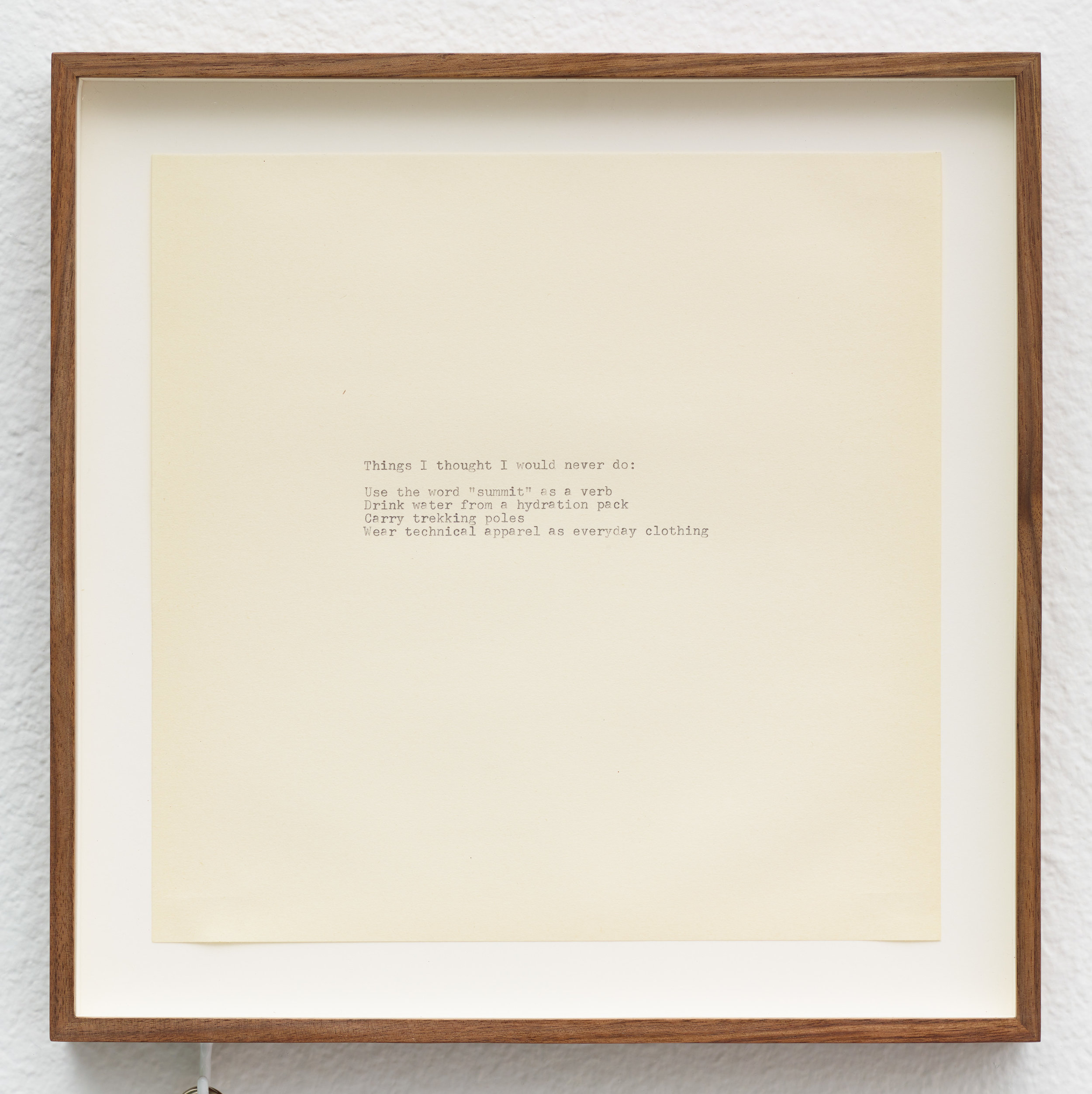 Last Modified October 29, 2012, 2:55PM / Gear List , 2018 (detail). Typewriter ink on paper, walnut frame with cup hook, three laminated inkjet prints, binder loop. 29 x 12 ¼ inches.