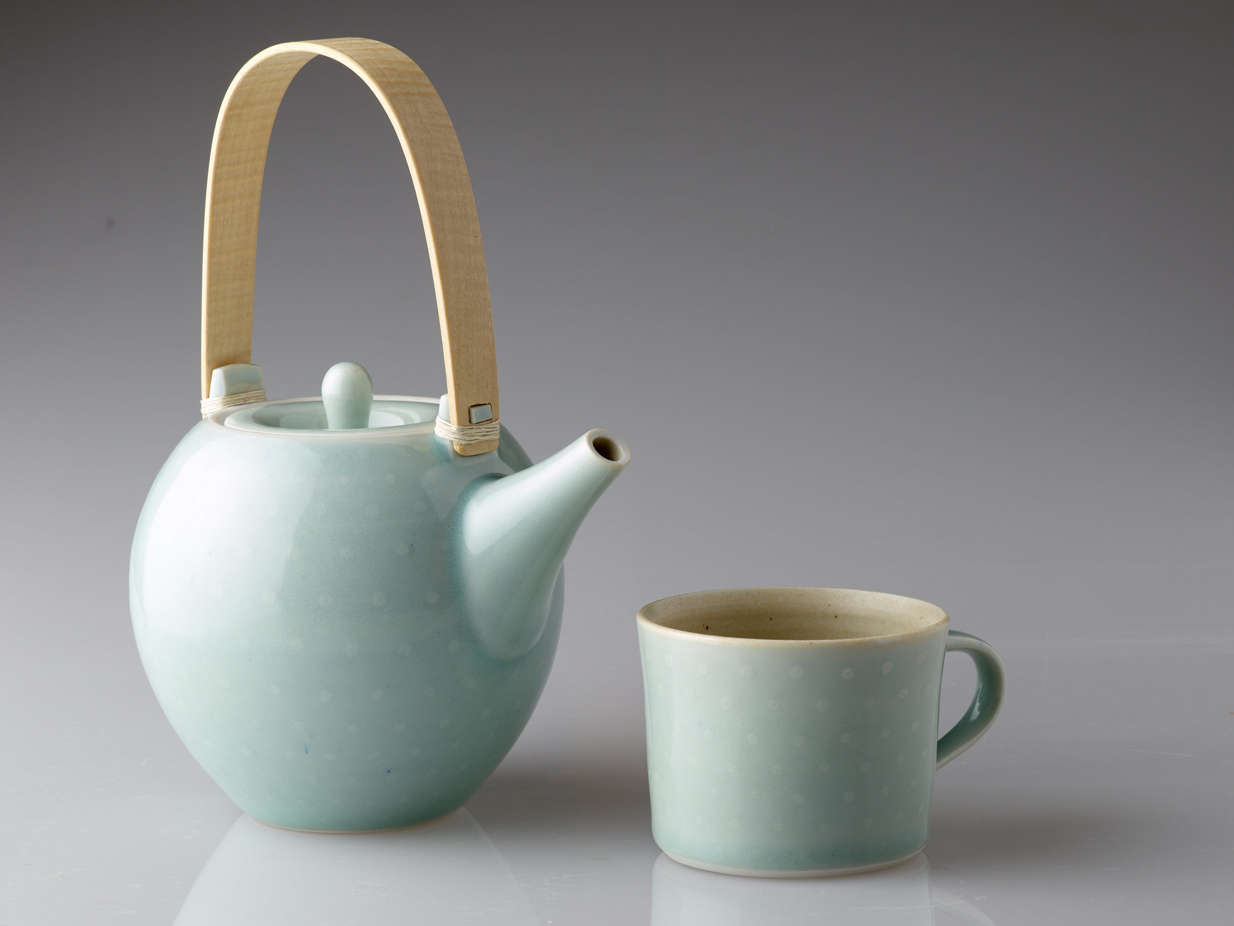 Celadon spot teapot with rippled maple handle
