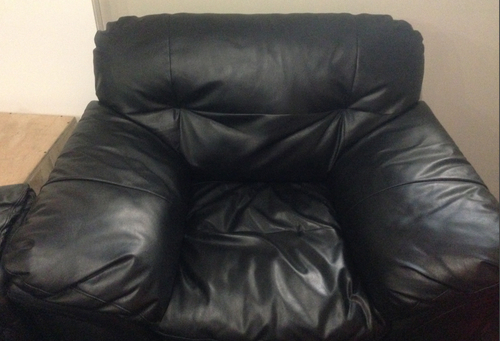 Our lovely new (to us) leather chair. It's comfy and fits right in.