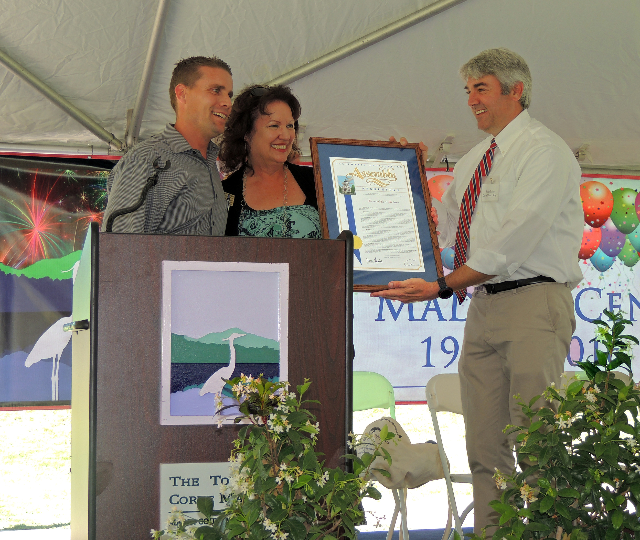 SENATOR MIKE MCGUIRE AND ASSEMBLY MEMBER MARC LEVINE'S FIELD REPRESENTATIVE JOAN LUBAMERSKY PRESENT A PROCLAMATION TO MAYOR SLOAN BAILEY, HONORING CORTE MADERA'S CENTENNIAL
