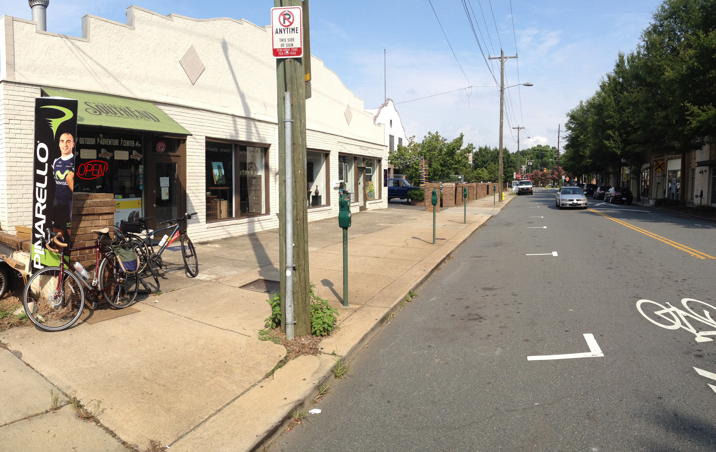 Before: Just another parking space in front of Queen City Bicycles in South End on E. Park Ave.