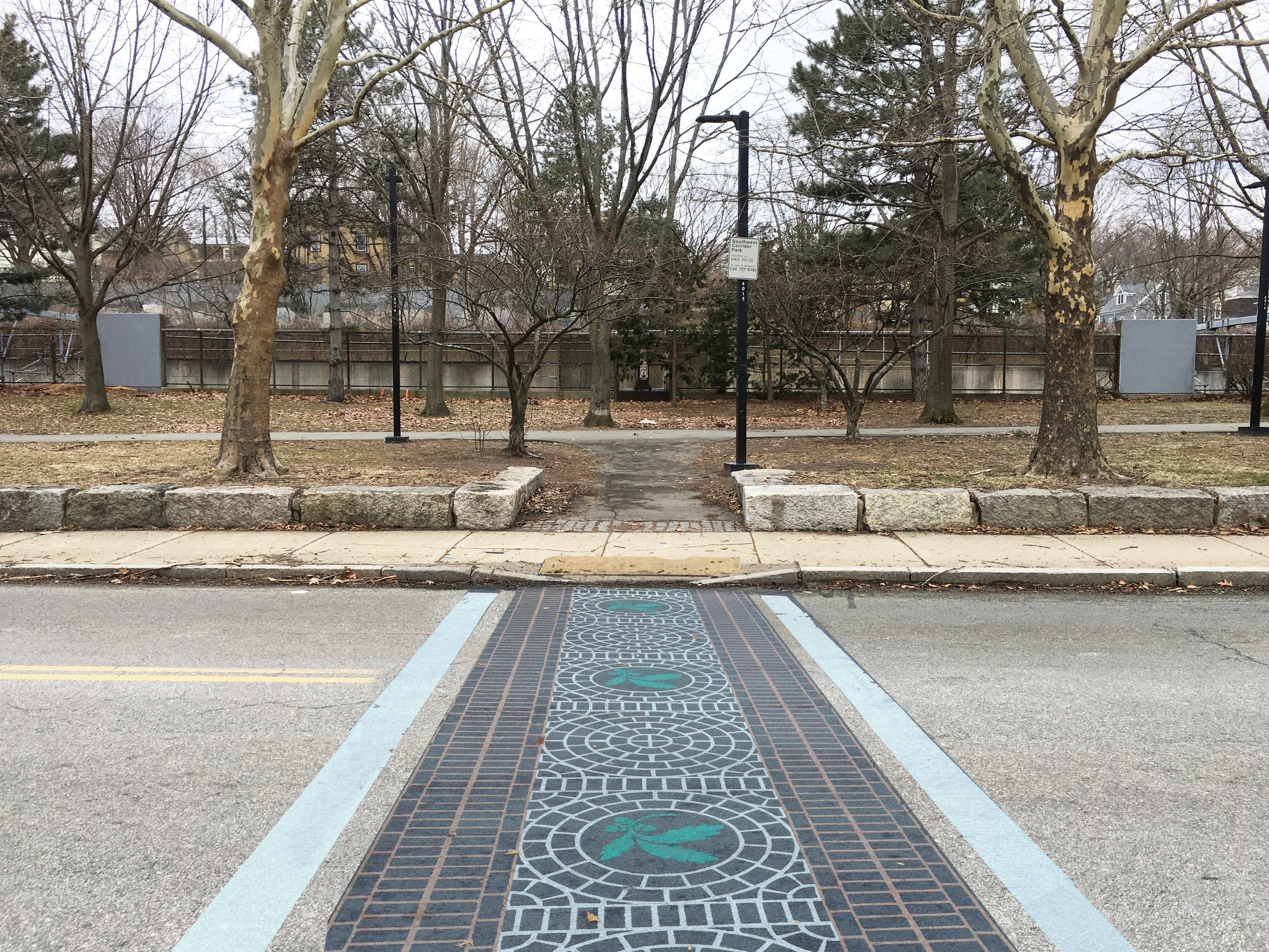 After:  Curb cut and colorful crosswalk to make the crossing safer.
