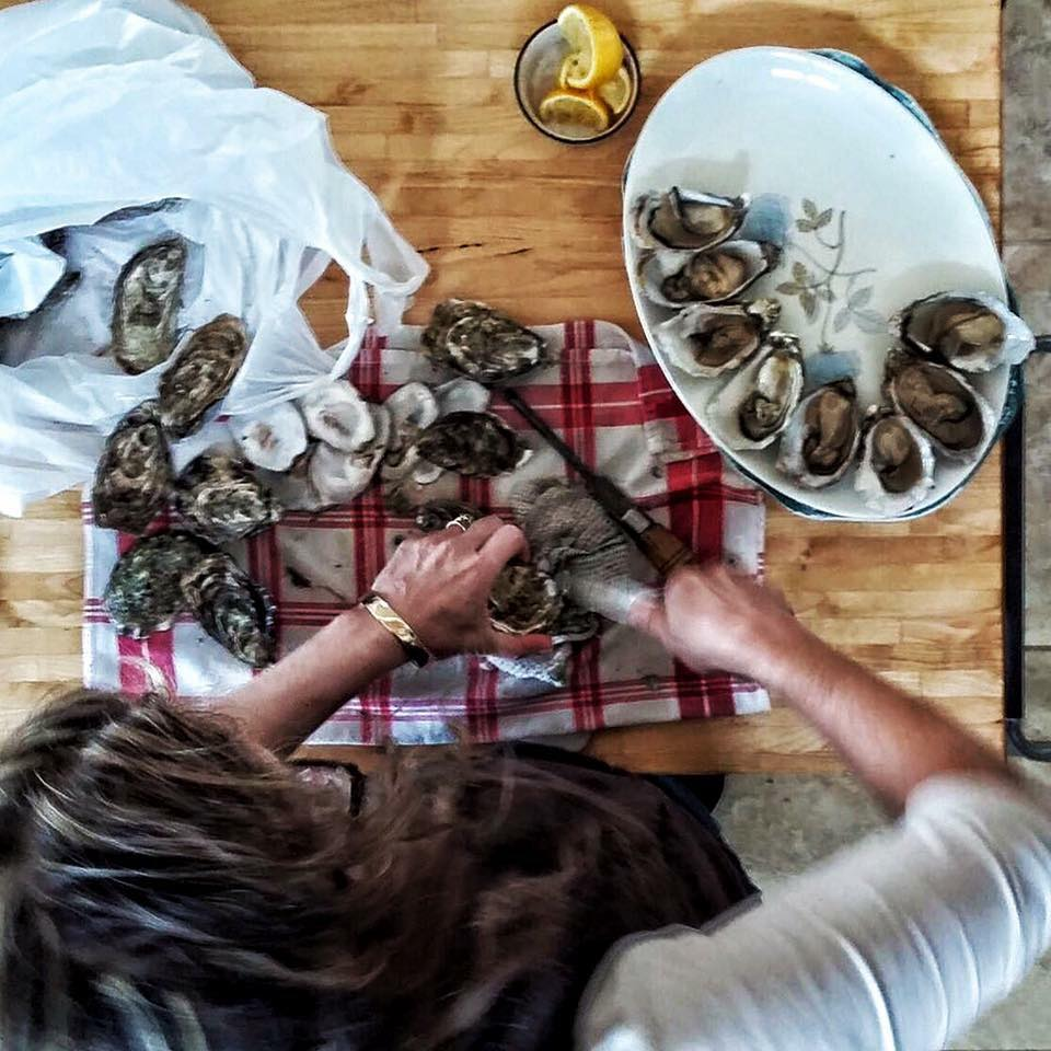 Shucking fresh oysters in Northern Ireland on Christmas morning in preparing for the long table feastive dinner.
