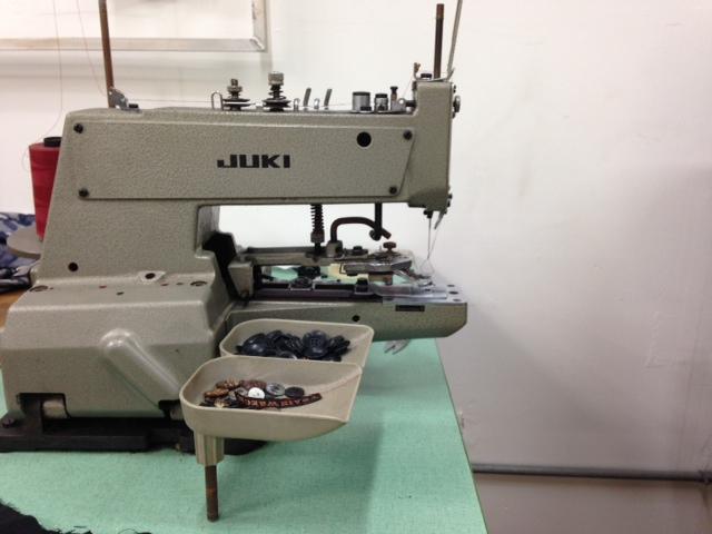 Button sewing machine.
