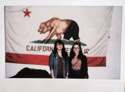 Sam and Liz in front of the Denim bruin flag