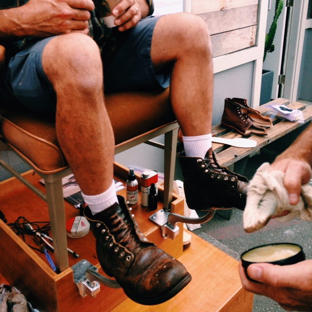 Michael Harris getting his boots shined by RedWing Heritage
