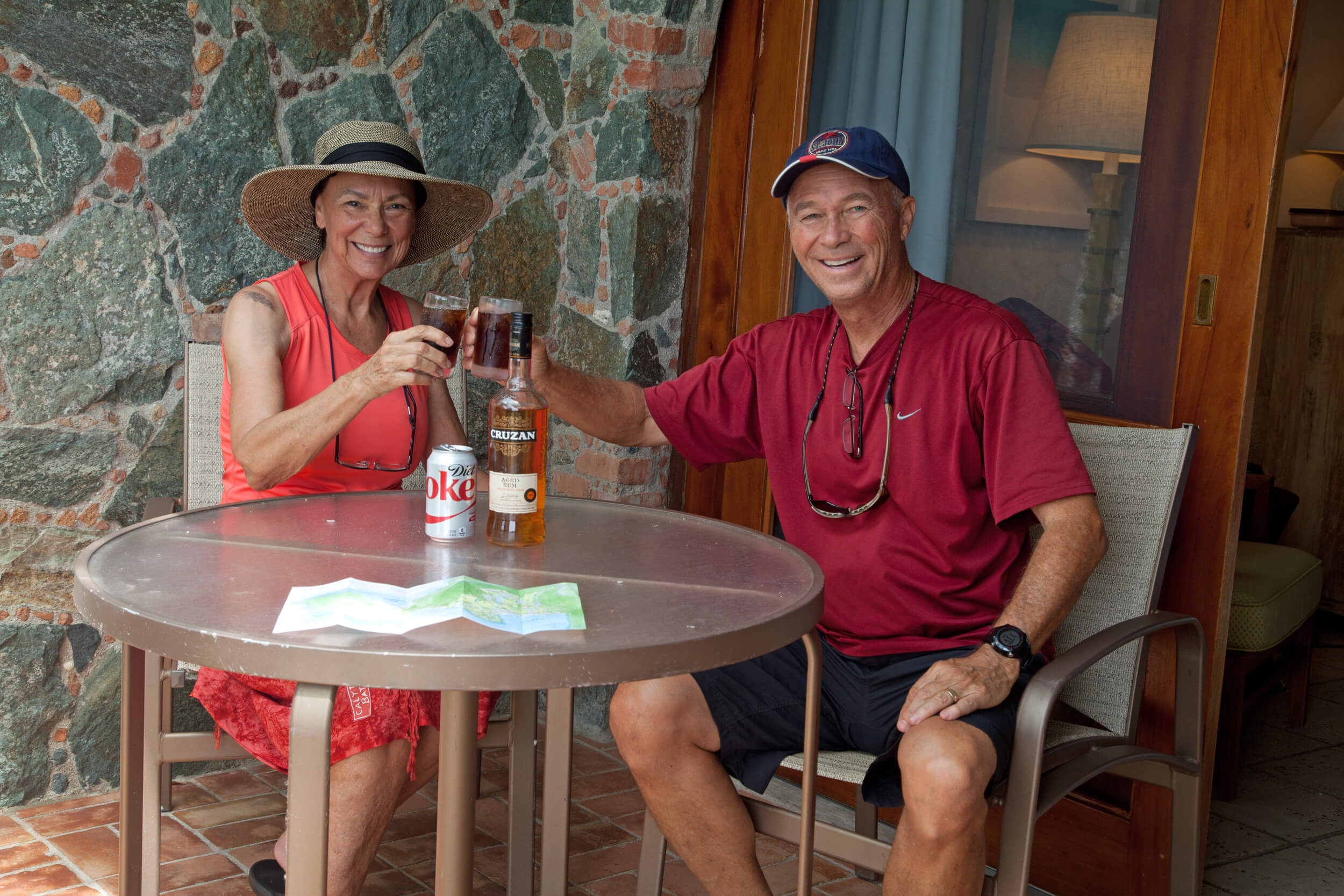 Roughing it with a bottle of rum at the Caneel Bay Resort.