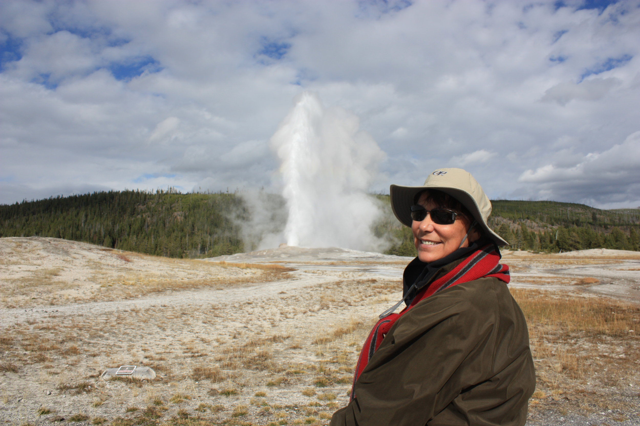 Yellowstone marks the beginning of our trek to all of the country's major National Parks. This incredible landscape was the country's first National Park and it was the  first  of the 59 major parks we would visit over the next 9 years. Terry enjoying the view of Old Faithful erupting in the background!