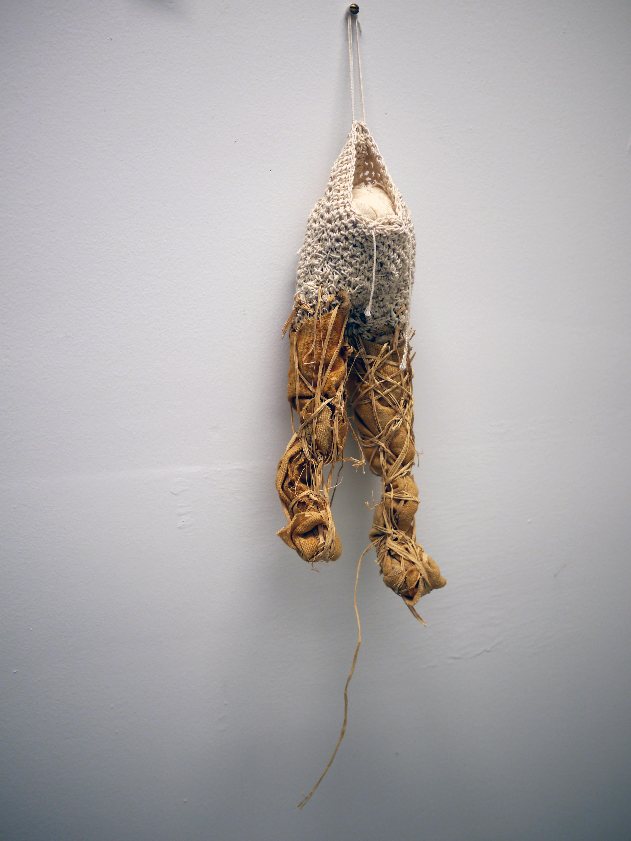 """Sarah Hewitt.  It . crocheted and woven cotton cord, raffia, rust dyed hemp, muslin. 24"""" x 5"""" x 3.5"""". 2013."""