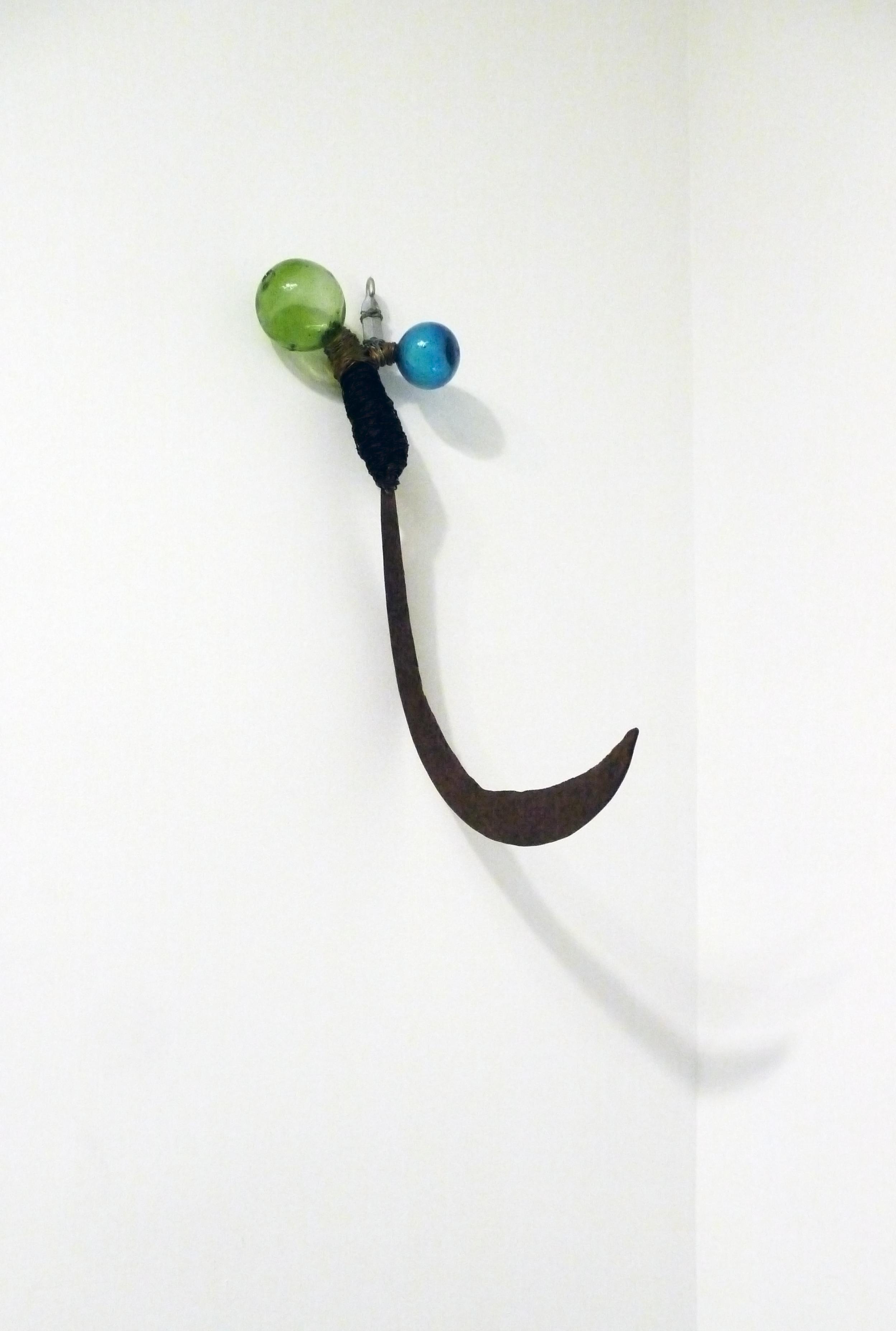 "Arthur Simms.  Tool . wire, metal, glass. 7"" x 21"" x 13"". 2003."