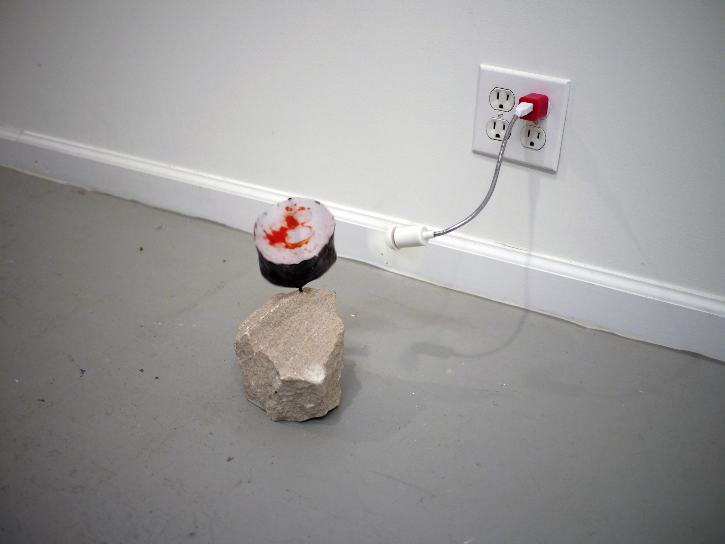 Tom Forkin.  Spinners . rock, collage, fan. dimensions variable. 2013.
