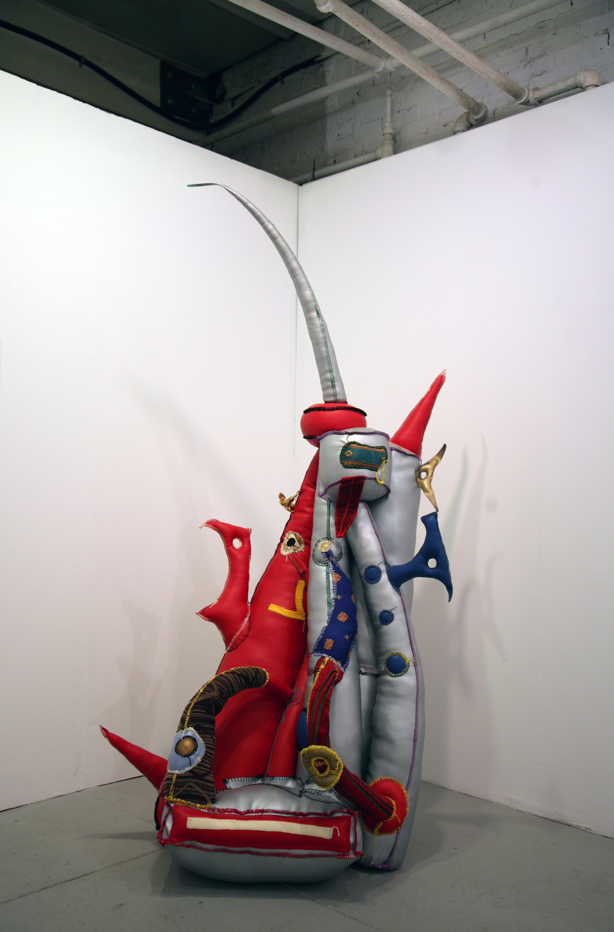R.M. Fischer.   RMF-3256  . Vinyl, fabric, felt, thread, polyester fiberfill and brass. 79 x 38 x 31 inches.