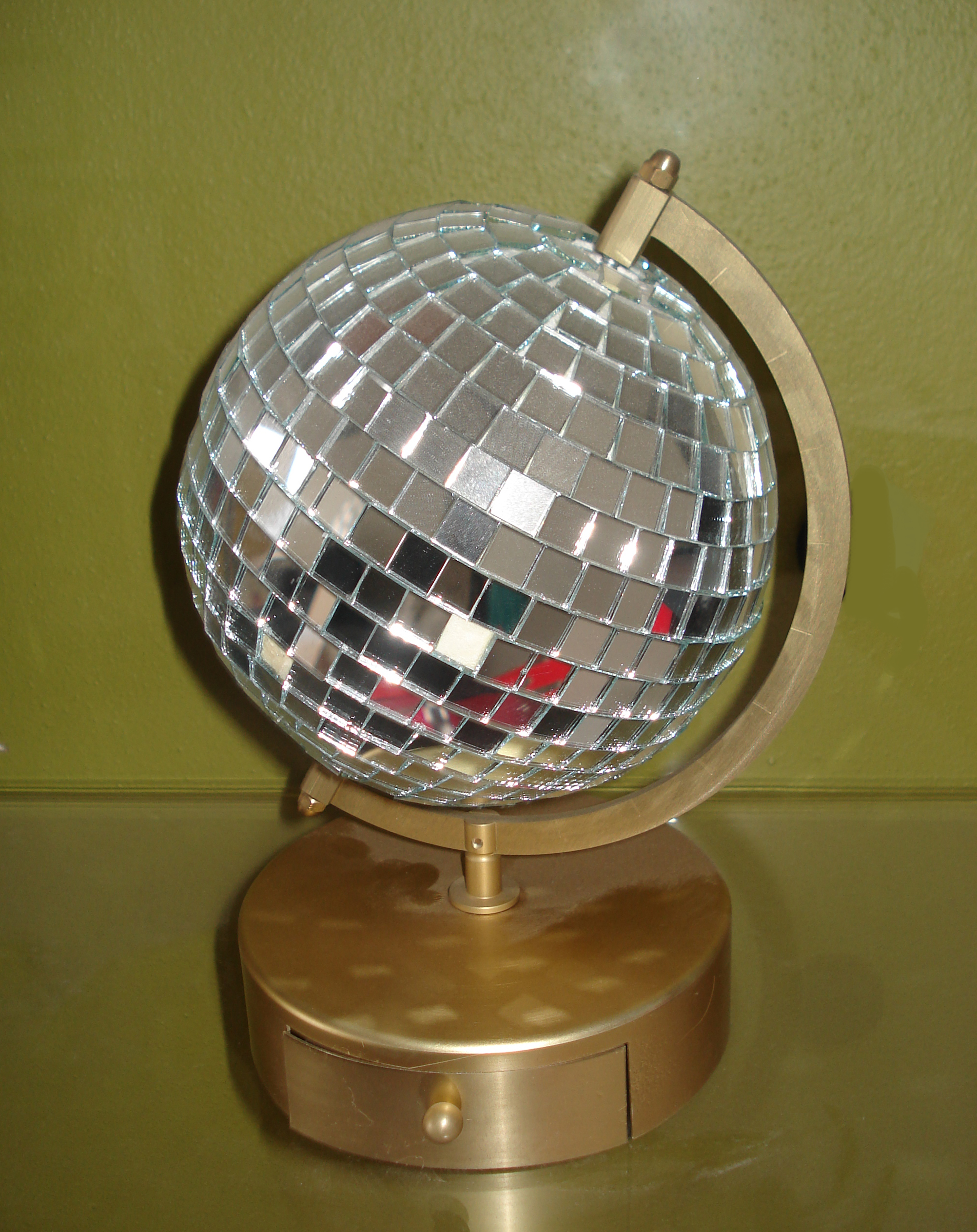 Disco ball with product drawer