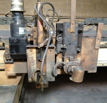BEFORE: Original front loaded cross axis drive, with right angle gearbox, square stock with roller bearings. Obsolete plasma lifter and air scribe.