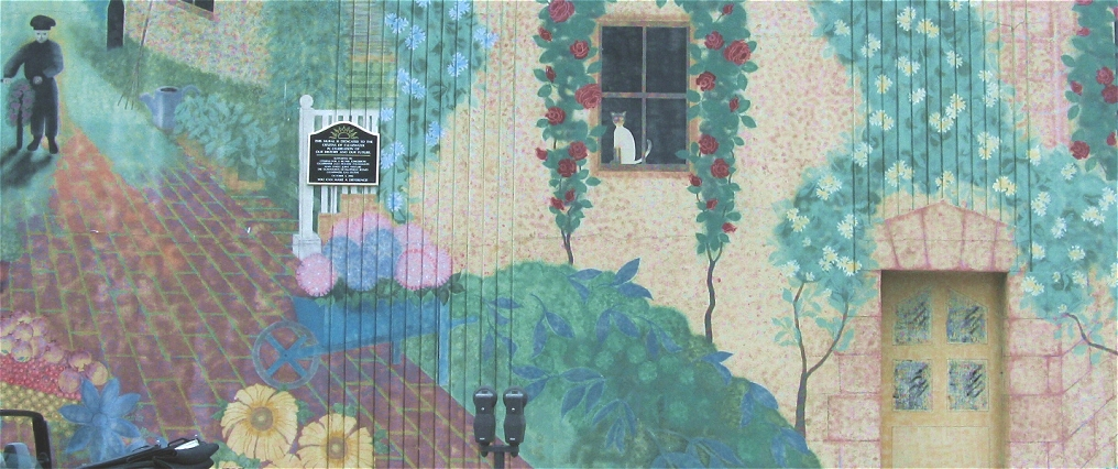 Section of the Avenue du Jardin exterior mural located in downtown Clearwater, Florida