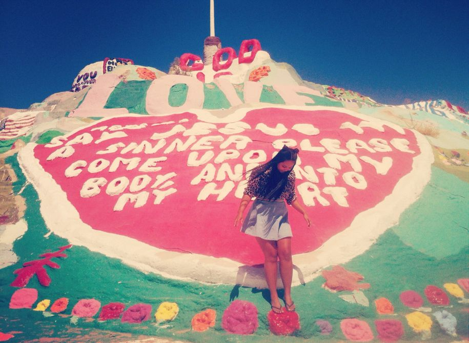 Playing at Salvation Mountain.