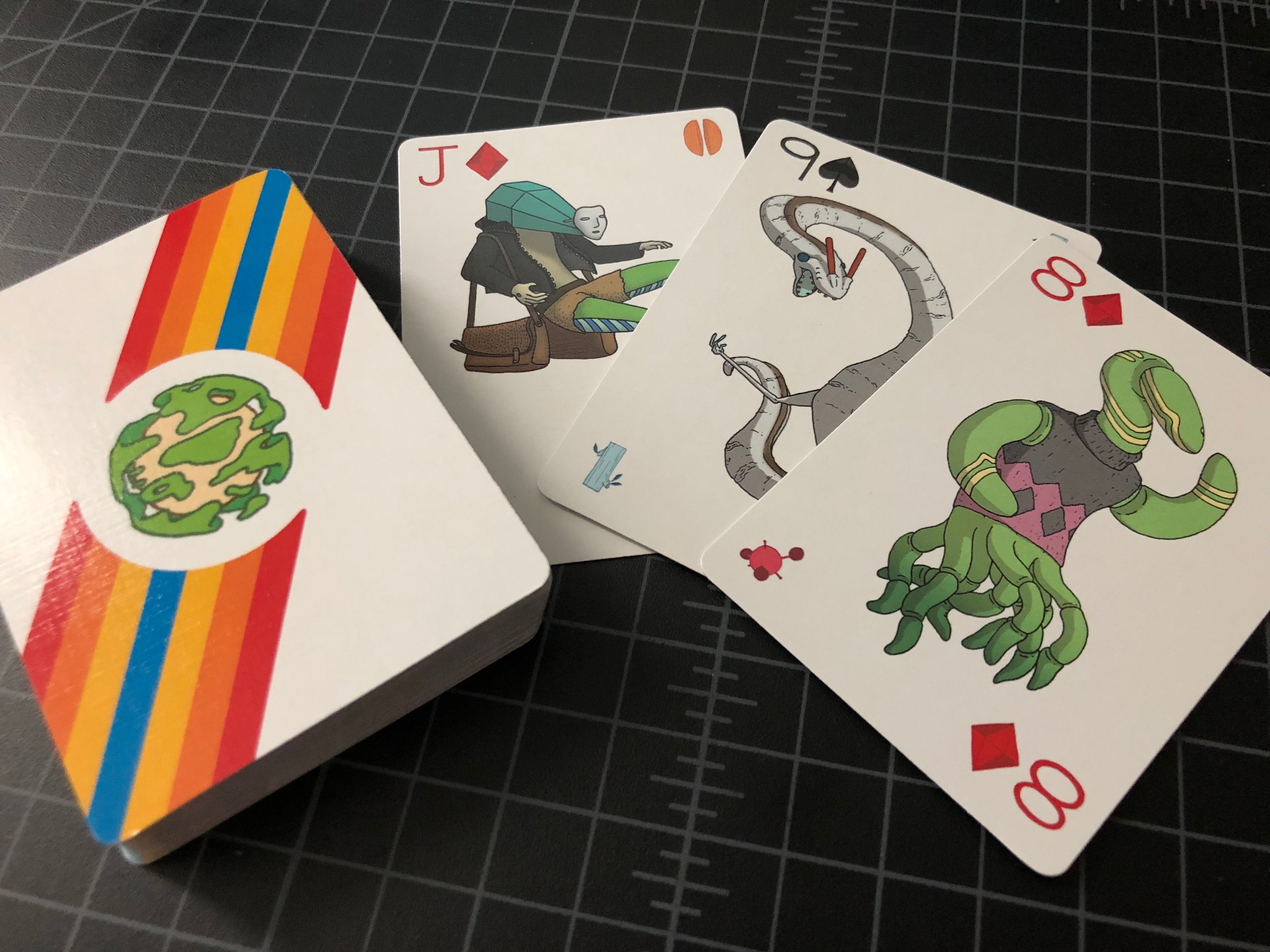 Orbital Primeval  playing cards by Nathan Smith