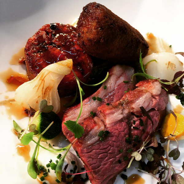 Bbq rump of herdwick lamb, braised shoulder, hotpot croquette, aubergine courgette and grelot (March).PNG