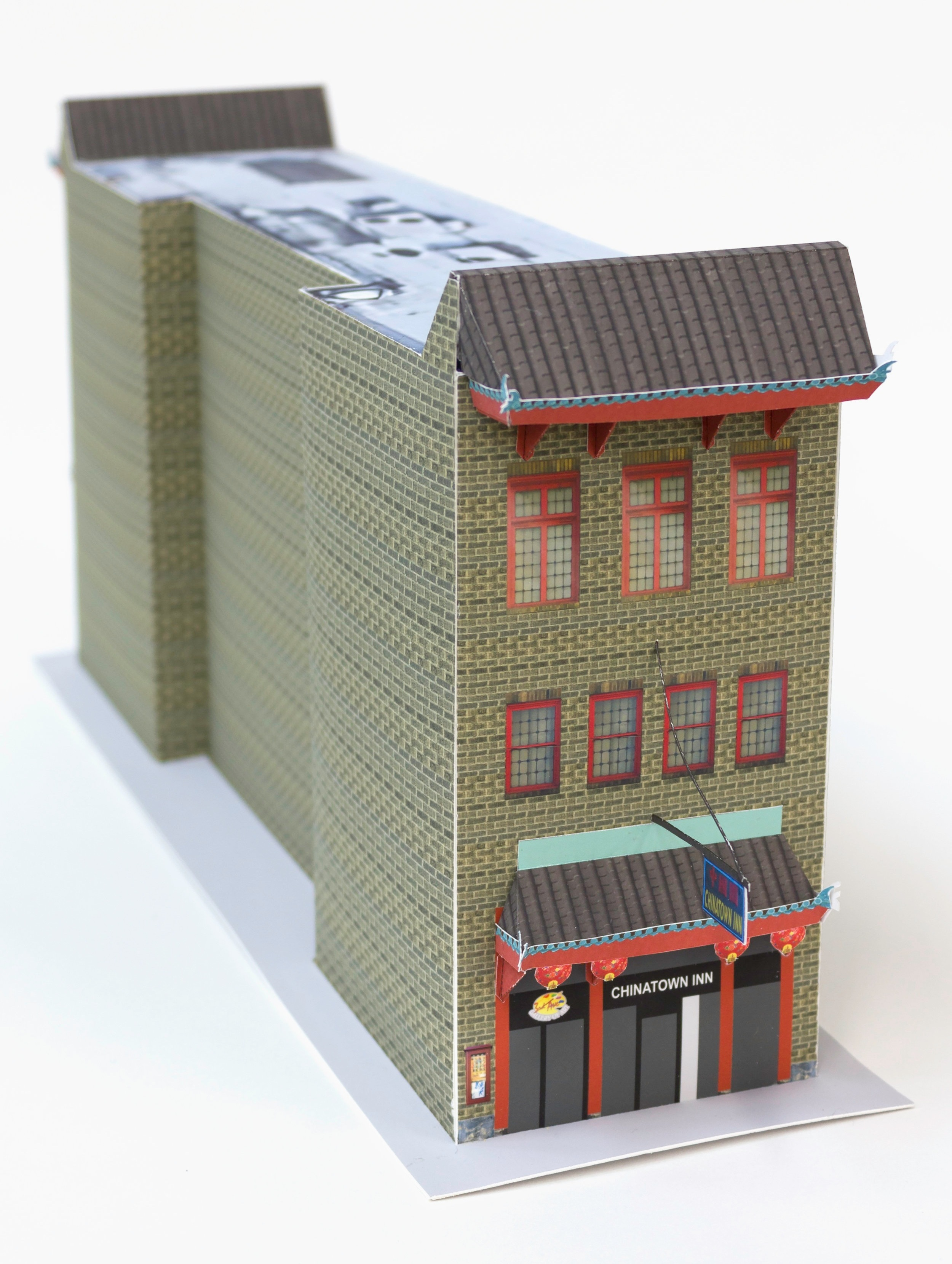 Pittsburgh's Chinatown, 2018   This is a DIY paper craft model of 520 Third Ave, the only remaining building with a physical trace of this city's historic Chinatown.  Pittsburgh's Chinatown formed in the late 1800's, a small part of the large migration of people traveling west during the Gold Rush. At its height in the 1920s, some 500 residents and 25 businesses called Second and Third Avenues between Ross and Grant Street their home. Chinatown's decline is due in part because the construction of the boulevard of the Allies that bisected the neighborhood.   Download and build your own   here.