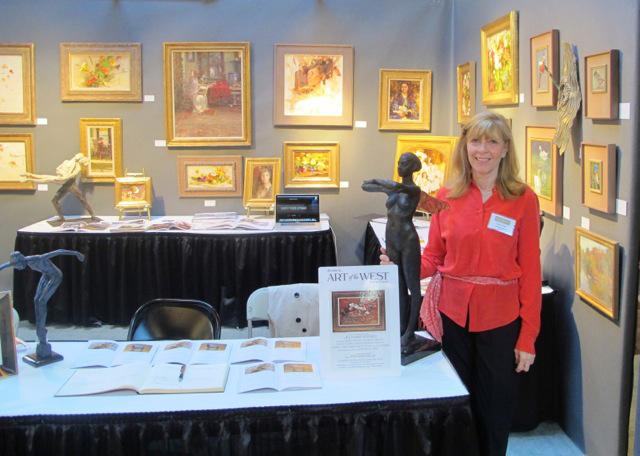 Kristen Thies in her gallery at West Wind Fine Art