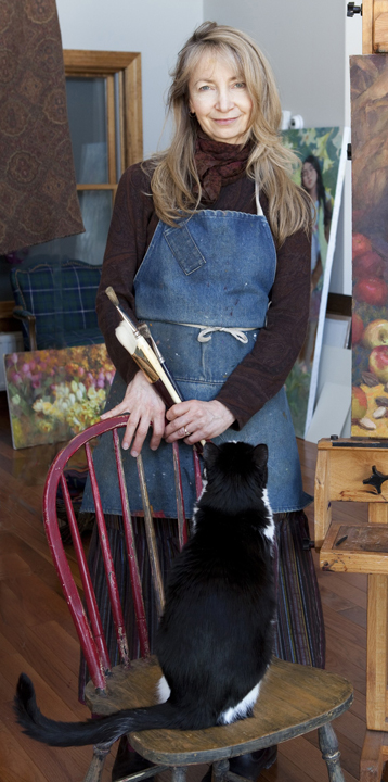 Nancy creating with her furry friend Zorro.