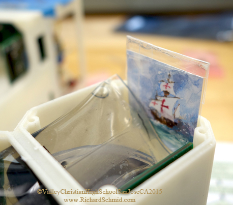 """SANTA MARIA II, Richard Schmid, Watercolor, 1.25""""x1.25""""   Painting being placed in the young scientist's experiment; the artwork is protected in glassine envelopes sealed with waterproof tape. (Now in orbit thanks to Valley Christian High School, San Jose, CA,  http://www.vcs.net/  )"""