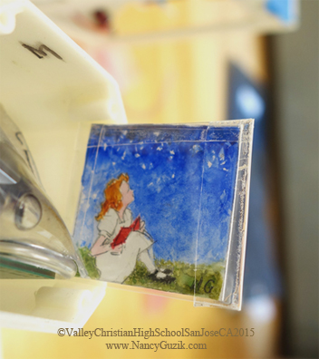 """STAR GAZER, Nancy Guzik, Watercolor, 1.25""""x1.25"""" Painting being placed in the young scientist's experiment; the artwork is protected in glassine envelopes sealed with waterproof tape. (Now in orbit thanks to Valley Christian High School, San Jose, CA, http://www.vcs.net/ )"""