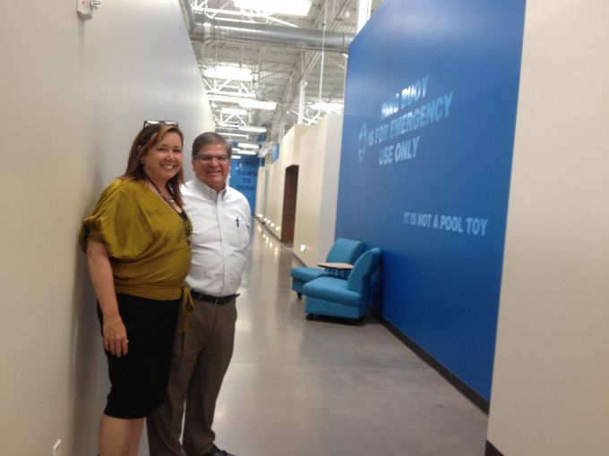 Architect Anne Sneed with Leslie's Swimming Pool Supplies Executive Vice President Steve Ortega in one of many huge, uncluttered, blue-accented express hallways at the new space.    (Photo: Laurie Merrill/The Arizona Republic)