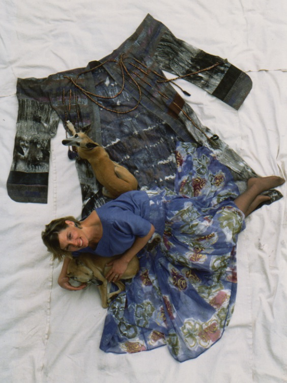 Gale Gassiot wearing hand-painted silk garments on silk kimono, posing with whippets, Canela and Flan.
