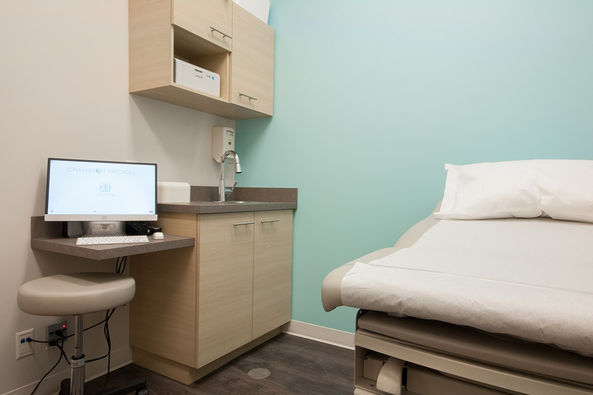 Cranston Medical Clinic Cranston,Calgary 2014  A project completed under the constraints of a limited budget and limited construction schedule. Strips of white vinyl applied in a unique pattern create a low-cost custom look behind the desk.
