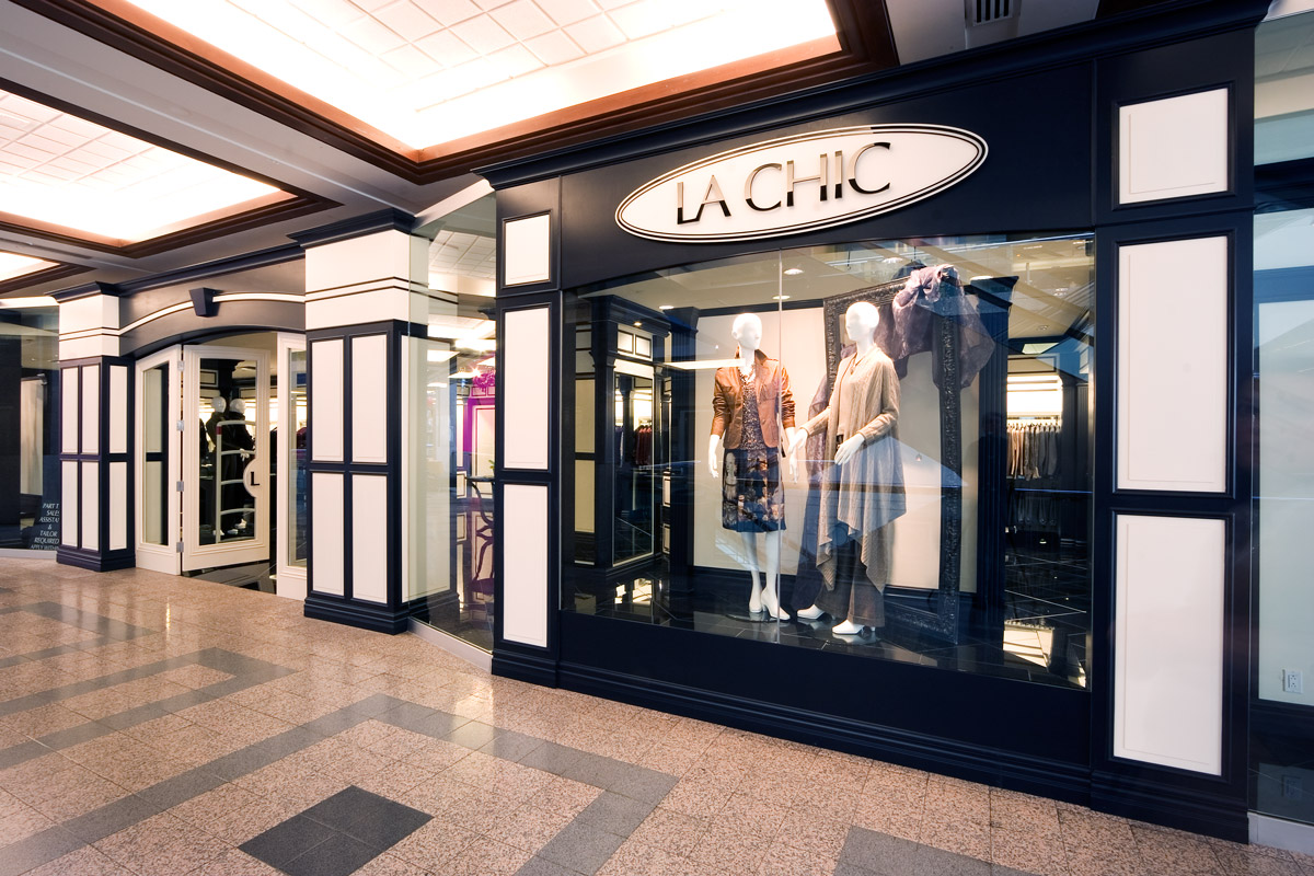 La Chic Bankers Hall, Calgary  A high-end boutique retail interior with a high-contrast color and lighting scheme designed to specifically enhance the look of the products for sale. Traditional detailing combined with modern finishes.