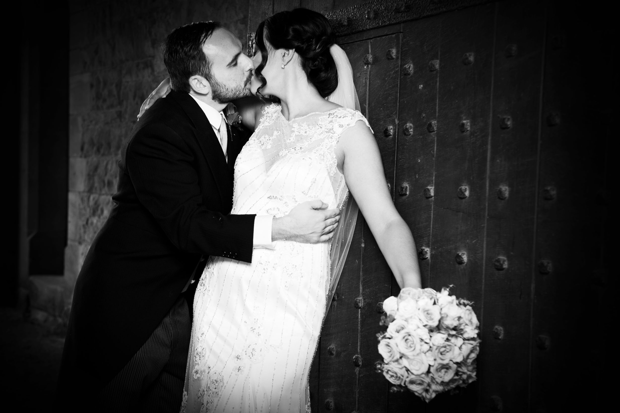 A black and white with strong contrast and a black vignette to focus the eyes -  Peckforton Castle
