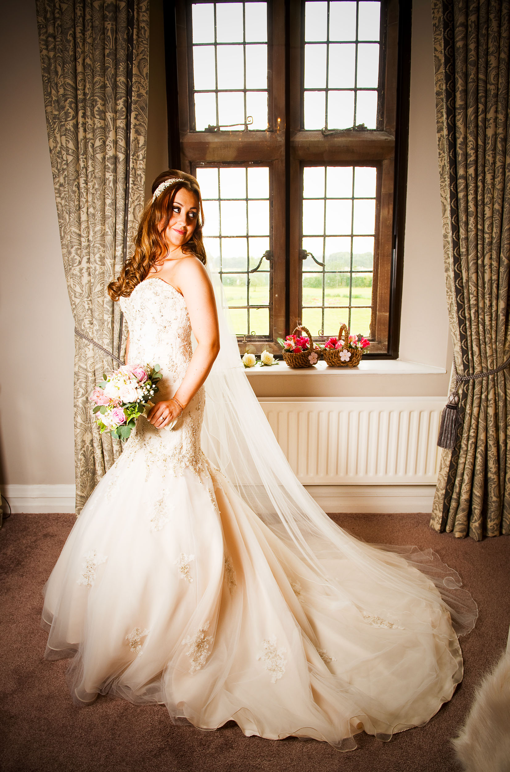 This beautiful bride was so excited on her wedding day. It was a pleasure to photograph her emotion at  Wrenbury Hall  in the bridal suite as she got ready