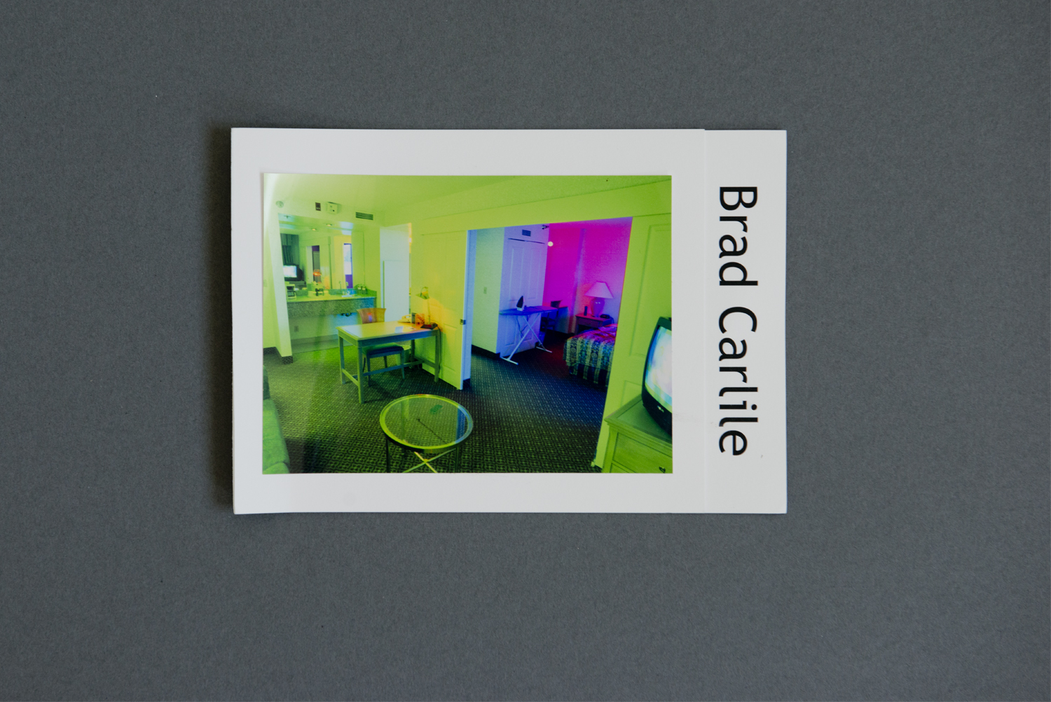 Graphically striking and neon-colored, Brad Carlile's promo card leapt out from our submission pile. The bright colors and distorted perspective of the front photograph are balanced by the bold, sans-serif font of his vertically oriented name.