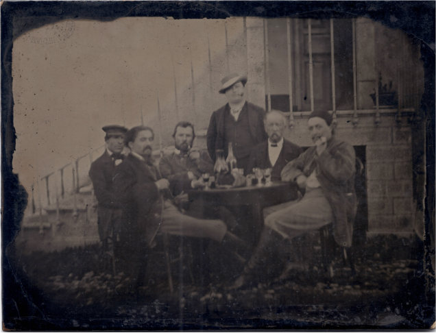 Vincent Van Gogh (third from the left) with friends at dinner.