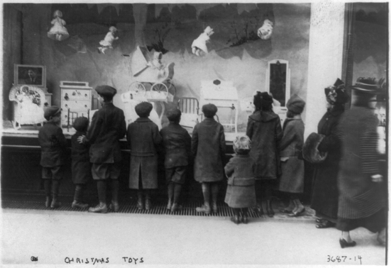 Children look through Macy's toy department window, New York City, c. 1908-1917.