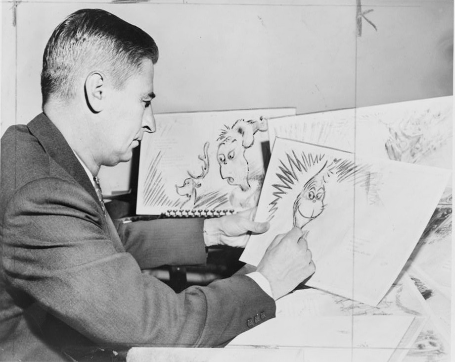 """Dr. Suess (Ted Geisel) at work on a drawing of a grinch, the hero of his forthcoming book, """"How the Grinch Stole Christmas,"""" 1957. Photo by Al Ravenna, World Telegram & Sun."""