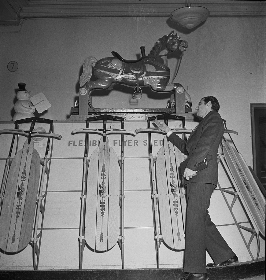 Toy department display at R.H. Macy and Company department store during the week before Christmas 1942. The hobby horse above costs almost one hundred dollars. Photo by Marjory Collins.
