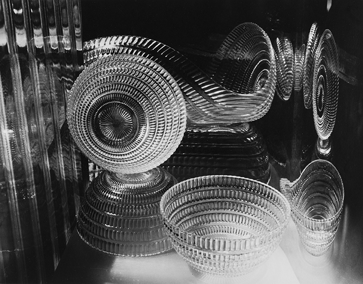 """Carlotta Corpron (American, 1901-1988), Glass Springs, 1945; 1993:26  During a period of intensive creative activity in the 1930s and 40s, Carlotta Corpron investigated the expressive potential of light in six successive series of photographs. Initially she experimented with solarization techniques and used the camera to record moving lights, making what she called """"light drawings."""" In the mid-1940s she began to concentrate on studies of light in a controlled studio setting. During this period the influential artists László Maholy-Nagy and Gyorgy Kepes, who were known for their photographic abstractions, relocated to Denton, Texas, where Corpron was teaching at Texas Women's University. In 1942 Corpron conducted a """"light workshop"""" at the university under the direction of Maholy-Nagy, who was one of the pioneers of the photogram, but it was Kepes, Maholy's former colleague, who influenced Corpron after his arrival in 1944. For a number of months Corpron met frequently with Kepes, who praised her work and which he described as """"light poetry."""""""