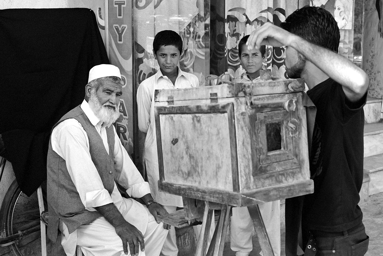 Mirzaman being photographed by his son, Kabul, 2012
